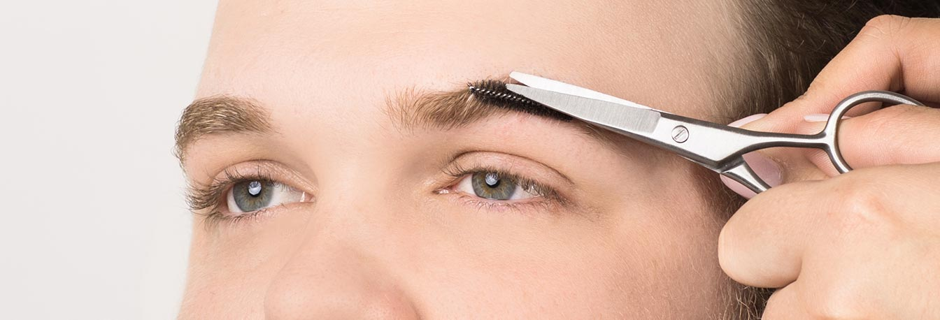 Using a spoolie, brush hairs upwards and trim those that are straggly or growing in an opposite direction. Brow hairs should be the same length, and trimming will control brow thickness and depth.
