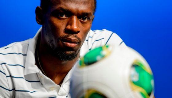 Usain Bolt recientemente entrenó con el Borussia Dortmund alemán. LA PRENSA/AFP/Fabrice COFFRINI