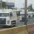 Policía Nacional escolta traslado de camiones nuevos de basura domiciliar