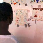 Migrantes rescatados cuentan en sus dibujos realistassus peores pesadillas, abusos e ilusiones