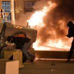 Miles de manifestantes se enfrentan a policías en el tercer día de protestas en Cataluña