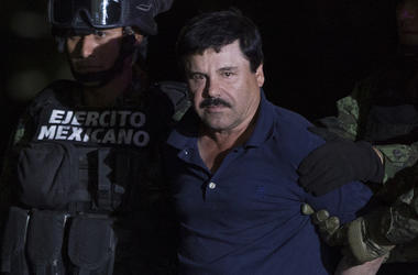 "(160109) -- MEXICO CITY, Jan. 9, 2016 (Xinhua) -- Soldiers escort Joaquin Guzman Loera, alias ""El Chapo"", upon his arrival to the hangar of the Attorney General's Office, in Mexico City, capital of Mexico, on Jan. 8, 2016. After an early morning raid in n"