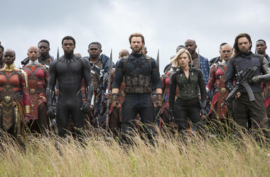 """This image released by Marvel Studios shows, front row from left, Danai Gurira, Chadwick Boseman, Chris Evans, Scarlet Johansson and Sebastian Stan in a scene from """"Avengers: Infinity War,"""" premiering on April 27. (Chuck Zlotnick/Marvel Studios via AP)"""
