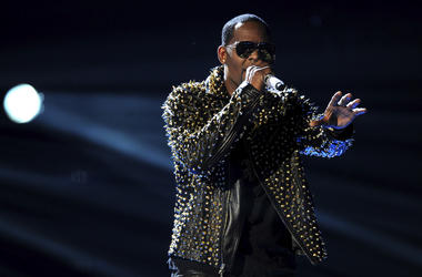 In this June 30, 2013, file photo, R. Kelly performs onstage at the BET Awards at the Nokia Theatre in Los Angeles. The Time's Up campaign is taking aim at R. Kelly over numerous allegations he has sexually abused women. The organization devoted to helpin