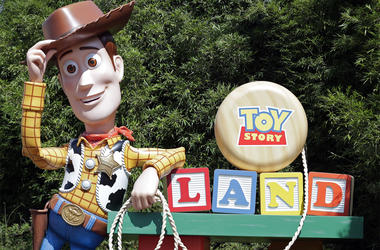 In this Saturday, June 23, 2018 photo, a statue of the character Sheriff Woody greets visitors at the entrance Toy Story Land in Disney's Hollywood Studios at Walt Disney World in Lake Buena Vista, Fla