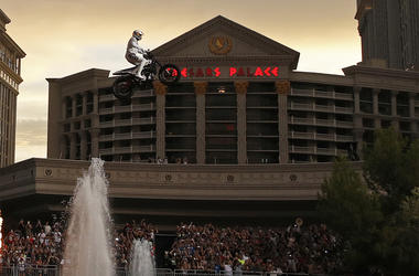 Travis Pastrana jumps the fountain at Caesars Palace on a motorcycle Sunday, July 8, 2018, in Las Vegas. Pastrana recreated three of Evel Knievel's iconic motorcycle jumps on Sunday, including the leap over the fountains of Caesars Palace that left Knieve