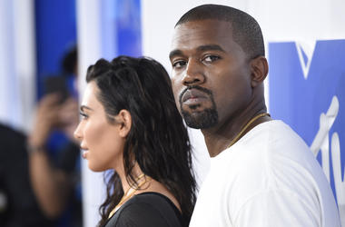"In this Aug. 28, 2016 file photo, Kim Kardashian West, left, and Kanye West arrive at the MTV Video Music Awards in New York. Kanye West has apologized on a Chicago radio station for suggesting slavery was a ""choice."" (Photo by Evan Agostini/Invision/AP,"