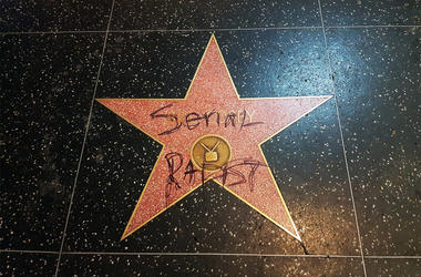 """This Monday, Sept. 3, 2018 photo shows Bill Cosby's star on the Hollywood Walk of Fame in Los Angeles after it was vandalized by someone who scrawled the words """"serial rapist"""" on it. Cosby was convicted in Philadelphia this year of aggravated indecent"""
