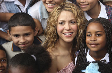 Colombian pop star Shakira posses with children after laying the cornerstone for a school her Barefoot Foundation will build in the Aranjuez neighborhood of Cartagena, Colombia, Friday, Nov. 2, 2018. (AP Photo/Pedro Mendoza)
