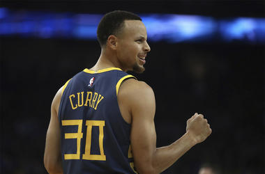 Golden State Warriors' Stephen Curry celebrates a score against the Memphis Grizzlies during the first half of an NBA basketball game Monday, Dec. 17, 2018, in Oakland, Calif. (AP Photo/Ben Margot)