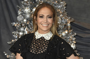 "In this Dec. 9, 2018 file photo, Jennifer Lopez attends a photocall for ""Second Act"" at the Four Seasons in Los Angeles. In the film, in theaters nationwide Friday, her business savvy character gets a shot to prove herself to Madison Avenue's elite thanks"