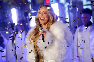 In this Dec. 31, 2017 file photo, Mariah Carey performs at the New Year's Eve celebration in Times Square in New York. A poll shows more Americans are favoring Christmas carols over recent Billboard hits, while longtime classics and recent comedies are th