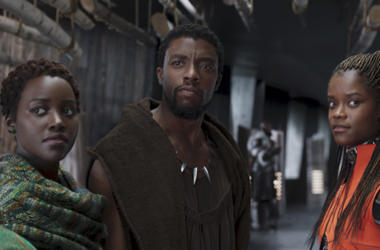 "This file image released by Disney shows Lupita Nyong'o, from left, Chadwick Boseman and Letitia Wright in a scene from ""Black Panther."" The producers behind hits ""Black Panther,"" ""Crazy Rich Asians,"" ""A Star Is Born"" and ""Bohemian Rhapsody"" are among the"