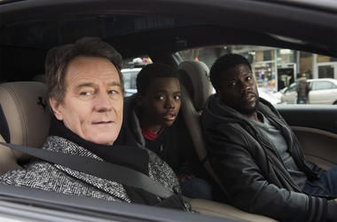 """This image released by STXfilms shows Bryan Cranston, from left, Jahi Di'Allo Winston, and Kevin Hart in a scene from """"The Upside."""" (David Lee/STXfilms via AP)"""