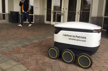A Starship robot stands by at George Mason University campus in Fairfax, Va., Wednesday, Jan. 23, 2019. A fleet of high-tech robots is now deployed at the northern Virginia university to serve the noble purpose of delivering pizza, doughnuts and coffee on