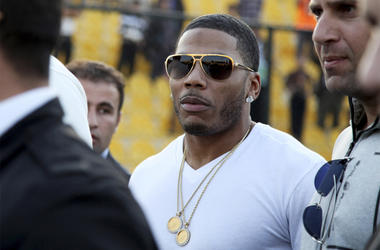 In this March 13, 2015 file photo, rapper Nelly approaches the stage for a concert in Irbil, northern Iraq. The St. Louis-based rapper is asking the federal court in his hometown to dismiss a British woman's lawsuit alleging that he sexually assaulted her