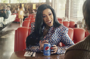 This screen grab from video provided by PepsiCo shows an image from the company's 2019 Super Bowl NFL football spot featuring Cardi B. Star power abounds in this year's Super Bowl ads. (PepsiCo via AP)