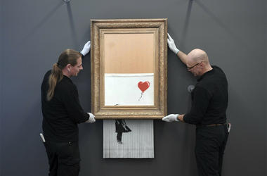 "The shredded Banksy painting ""Love is in the Bin 'is being exhibited at the Museum Frieder Burda in Baden-Baden Monday Feb. 4, 2019, where the work will be shown from Feb. 5 to March 3, 2019. It was originally titled 'Girl with Balloon' and since it destr"
