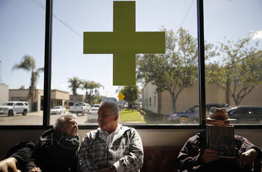 In this Feb. 19, 2019 photo, Kay Nelson, left, and Bryan Grode, retried seniors from Laguna Woods Village, chat in the lobby of Bud and Bloom cannabis dispensary while waiting for a free shuttle to arrive in Santa Ana, Calif.  (AP Photo/Jae C. Hong)