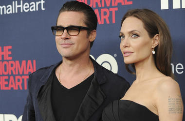 "In this May 12, 2014 file photo, Brad Pitt and Angelina Jolie attend the premiere of HBO Films' ""The Normal Heart"" at the Ziegfeld Theatre in New York. (Photo by Evan Agostini/Invision/AP, File)"