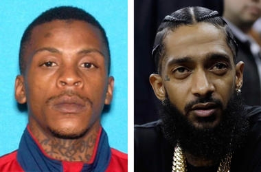 (L-R) Eric Holder and rapper Nipsey Hussle (Photo credit: Los Angeles Police Department/AP Photo/Marcio Jose Sanchez, File)