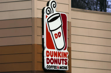 "This Jan. 22, 2018, file photo shows the Dunkin' Donuts logo on a shop in Mount Lebanon, Pa. First, Dunkin' dropped the ""Donuts"" from its name. Now, it's adding espresso drinks to its menu. Dunkin' says most of its 9,200 U.S. stores will offer lattes, cap"