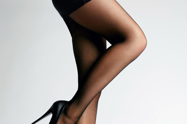 Black Tights. Female Legs With Pantyhose. High, style. (Photo credit: Puhhha/Dreamstime)
