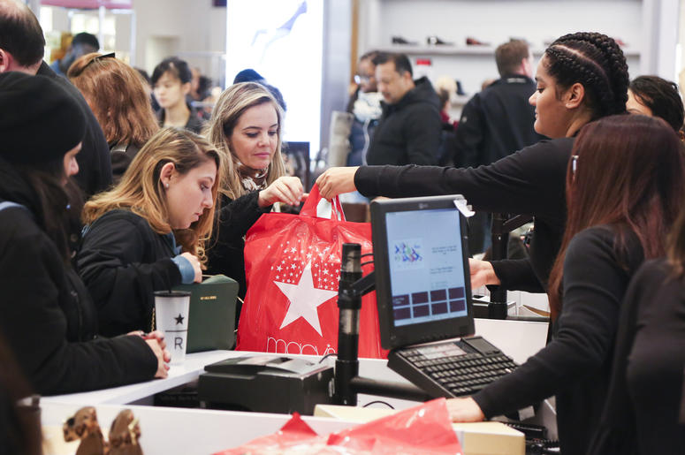 NEW YORK, Nov. 24, 2017 (Xinhua) -- People shop at a Macy's store during Black Friday in New York, the United States, Nov. 24, 2017. Although online shopping becomes increasingly convenient for Black Friday, some people still enjoy shopping in stores due
