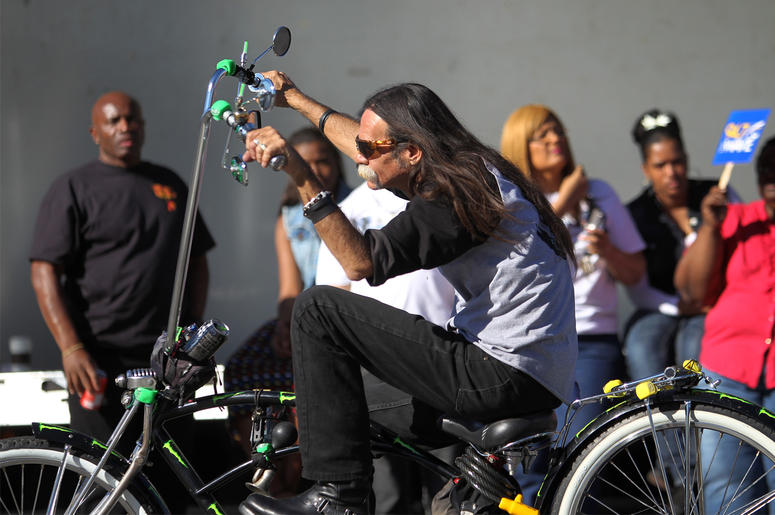 Annual MLK Day Parade Marches Through Los Angeles LOS ANGELES, CA - JANUARY 20: A man rides a custom lowrider bicycle in the 29th annual Kingdom Day Parade on January 20, 2014 in Los Angeles, California. The Kingdom Day Parade honors the memory of African