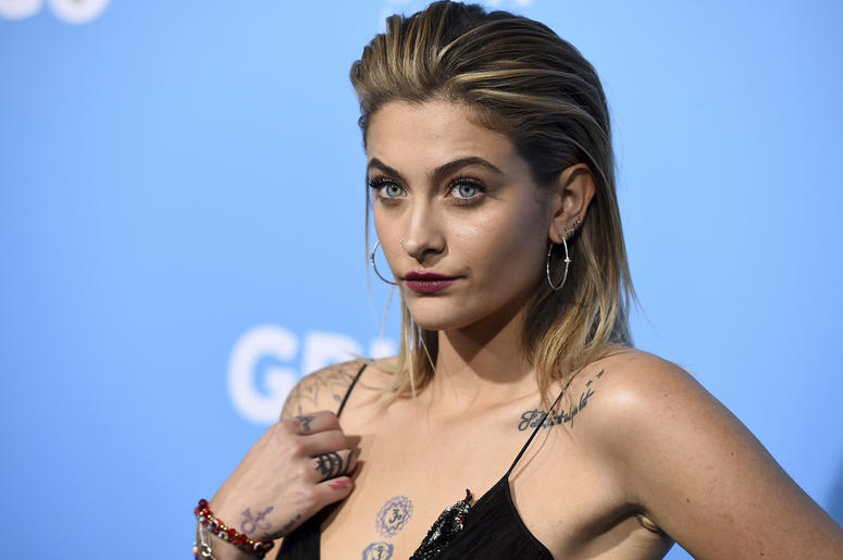 """In this March 6, 2018 file photo, Paris Jackson arrives at the Los Angeles premiere of """"Gringo"""" at Regal L.A. Live. Paris Jackson has posted an online tribute to her grandfather, Joe Jackson, who died at the age of 89. On Instagram, the 20-year-old shared"""