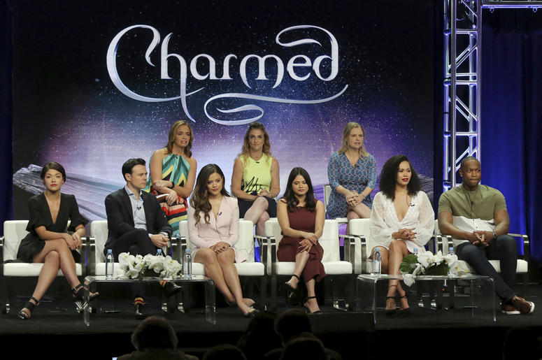 "Executive producers Jessica O'Toole, from back row left, Jennie Snyder Urman, Amy Rardin, and from front row left, Ellen Tamaki, Rupert Evans, Sarah Jeffery, Melonie Diaz, Madeleine Mantock and Ser'Darius Blain participate in the ""Charmed"" panel during th"