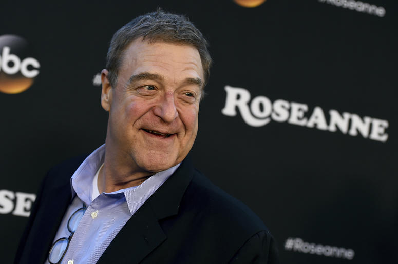 "In this March 23, 2018 file photo, John Goodman arrives at the Los Angeles premiere of ""Roseanne"" in Burbank, Calif. Goodman is speculating that this fall's ""Roseanne"" spinoff will mean curtains for the matriarch played by Roseanne Barr. In an interview w"