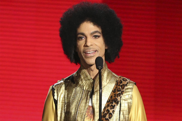In this Nov. 22, 2015 file photo, Prince presents the award for favorite album - soul/R&B at the American Music Awards in Los Angeles. Ava DuVernay is making a multi-part documentary on Prince for Netflix with the support of the late musician's estate. Th