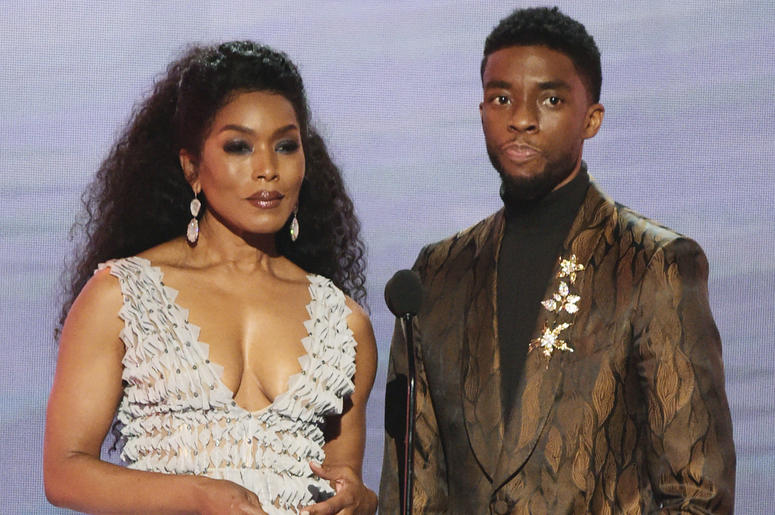 "In this Jan. 27, 2019, file photo, Angela Bassett, left, and Chadwick Boseman, nominated for outstanding performance by a cast in a motion picture, introduce a clip from their film ""Black Panther"" at the 25th annual Screen Actors Guild Awards at the Shrin"