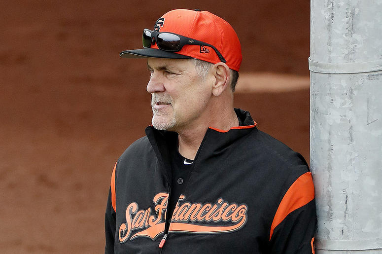 In this Feb. 13, 2019, file photo, San Francisco Giants manager Bruce Bochy watches his team during a baseball spring training practice, in Scottsdale, Ariz. Bochy says he will retire after this season, his 25th as a big league manager. Bochy says he told