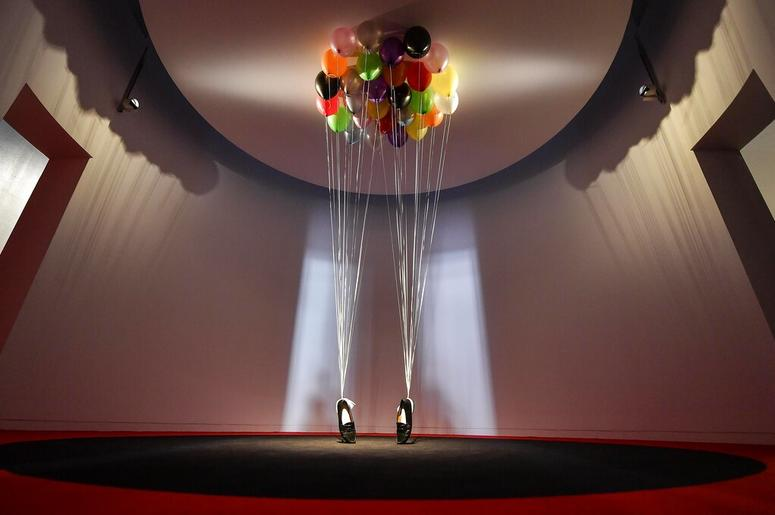 sculpture, comprised of balloons lifting a pair of penny loafer shoes by British artist Appau Junior Boakye-Yiadom is shown at a preview of the exhibition 'Michael Jackson: On The Wall' at the Bundeskunsthalle museum in Bonn, Germany, Thursday, March 21,