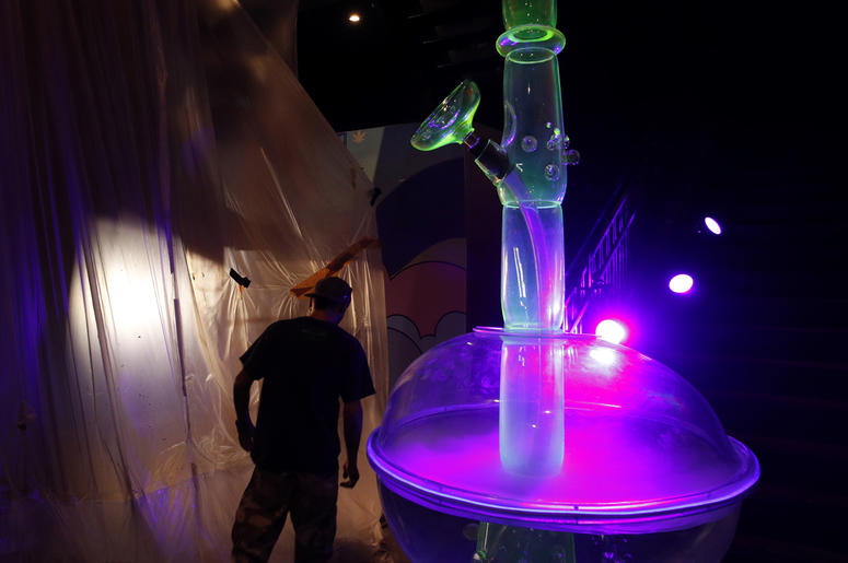In this Tuesday, Sept. 18, 2018 photo, a man walks by a 24-foot-tall bong at the Cannabition cannabis museum in Las Vegas. The museum celebrating all things cannabis with displays that include a glass bong taller than a giraffe and huggable faux marijuana