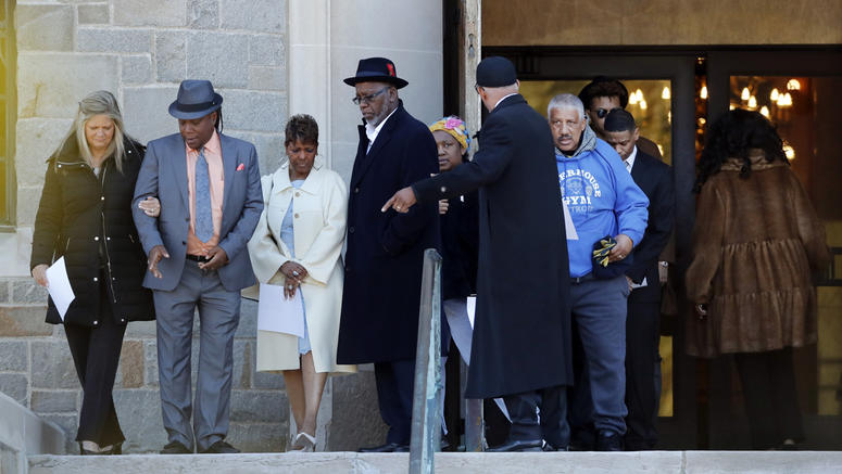 Family members of the late Aretha Franklin gather before entering the Mausoleum Chapel at the Woodlawn Cemetery, Monday, March 25, 2019, in Detroit. (AP Photo/Carlos Osorio)