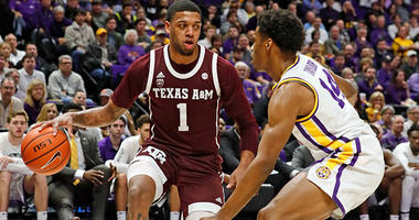 Texas A&M Aggies guard Savion Flagg (1) dribbles against LSU Tigers guard Marlon Taylor (14) in the first half at Maravich Assembly Center.