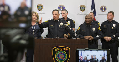 Houston police: Officer is shot after suspects beat priest