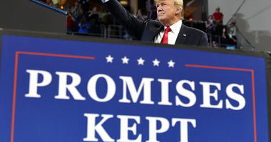 Trump defends his hard-line immigration policies to cheers