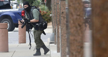 Masked gunman opens fire on Dallas courthouse, then dies