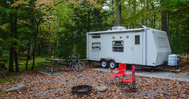 camper trailer on a pad at campground