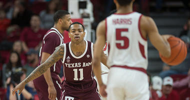 exas A&M Aggies guard Wendell Mitchell (11) watches Arkansas Razorbacks guard Jalen Harris (5) bring the ball up the court during the first half at Bud Walton Arena.