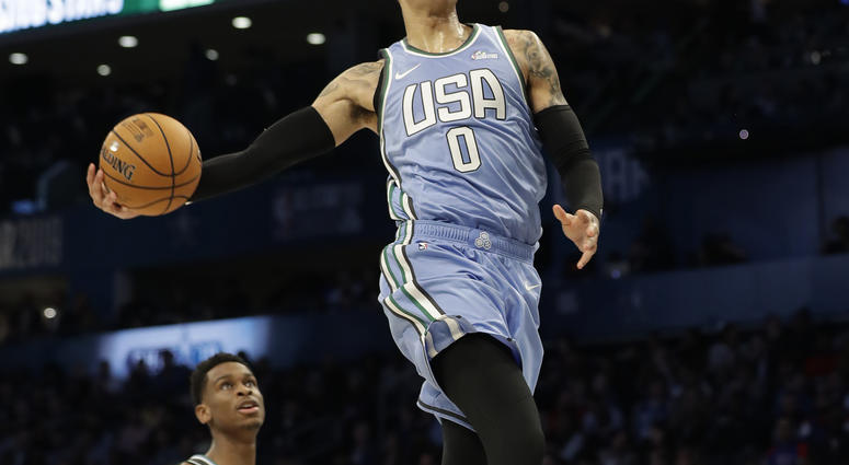 5804f82a7a9 U.S. Team's Kyle Kuzma, of the Los Angeles Lakers heads to the hoop for a  dunk against the World Team during the NBA All-Star Rising Stars basketball  game, ...