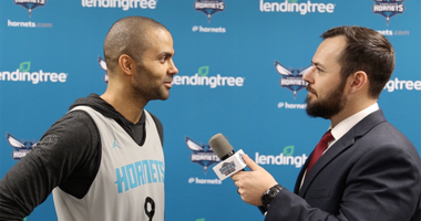 Kyle Bailey chats with Hornets guard Tony Parker