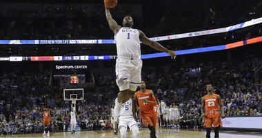 d04d9ea2c289 Duke s Zion Williamson (1) goes up to dunk against Syracuse during the  first half of an NCAA college basketball game in the Atlantic Coast  Conference ...