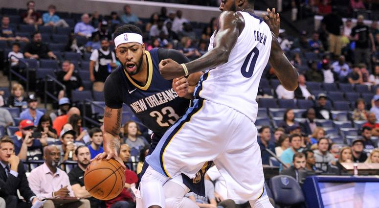 Oct 13, 2017; Memphis, TN, USA; New Orleans Pelicans forward Anthony Davis (23) handles the ball against Memphis Grizzlies forward JaMychal Green (0) during the first half at FedExForum.