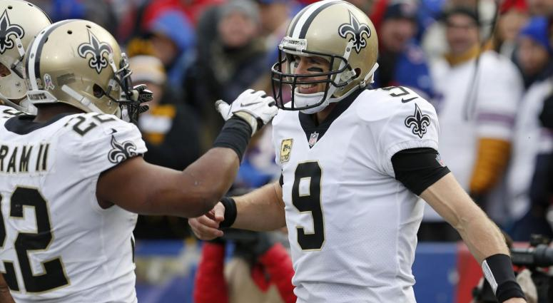 Nov 12, 2017; Orchard Park, NY, USA; New Orleans Saints quarterback Drew Brees (9) celebrates his touchdown with running back Mark Ingram (22) during the second half against the Buffalo Bills at New Era Field.