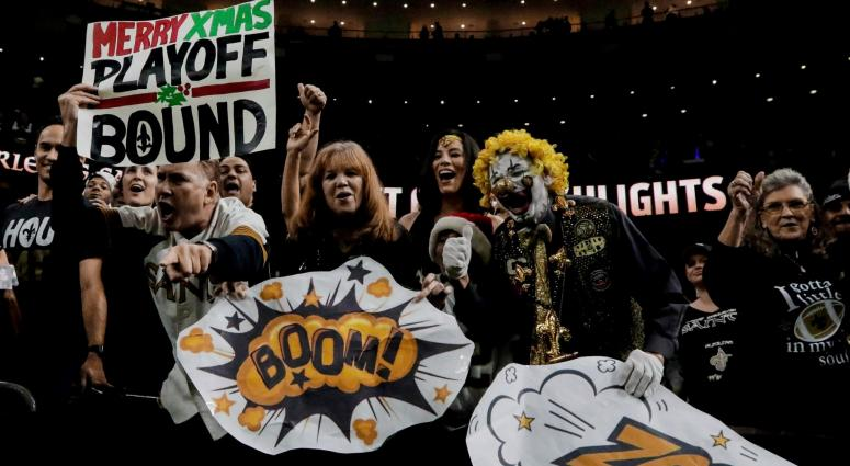 Dec 24, 2017; New Orleans, LA, USA; New Orleans Saints fans celebrate after a win against the Atlanta Falcons to clinch a playoff birth at the Mercedes-Benz Superdome. The Saints defeated the Falcons 23-13.